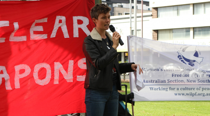 Activist Gemma Romuld addresses a crowd in Sydney, protesting Australia's boycott of treaty negotiat