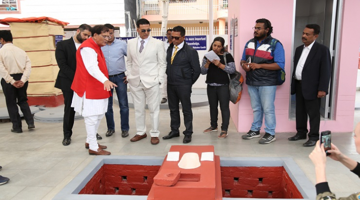 Dr. Pathak showing  a toilet to famous Indian Bolywood Actor Akshay Kumar (Photo: Jasvinder Sehgal)