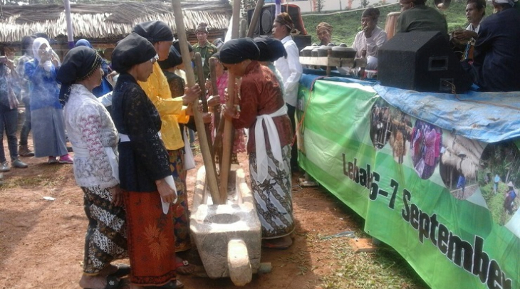 The women here at Cirompang village in Banten province, are making music with their mortars as a sig