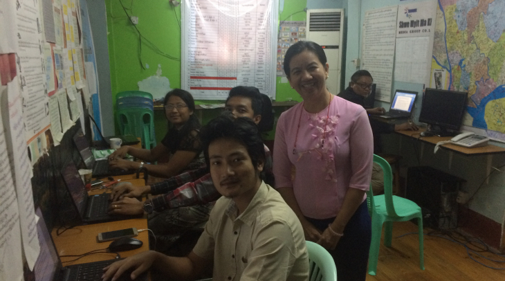 Journalist May Thingyan Hein (standing) in the newsroom at Myit Makha Media Agency in Yangon (Photo: