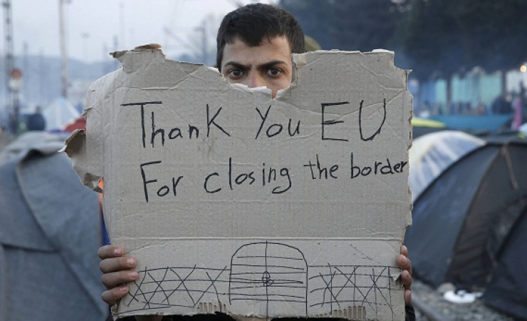A refugee holds the message