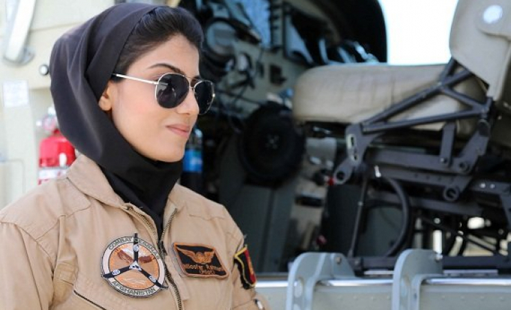 The first female pilot in Afghan Niloofar Rahmani get up to her plane. (Photo: Ghayor Waziri)