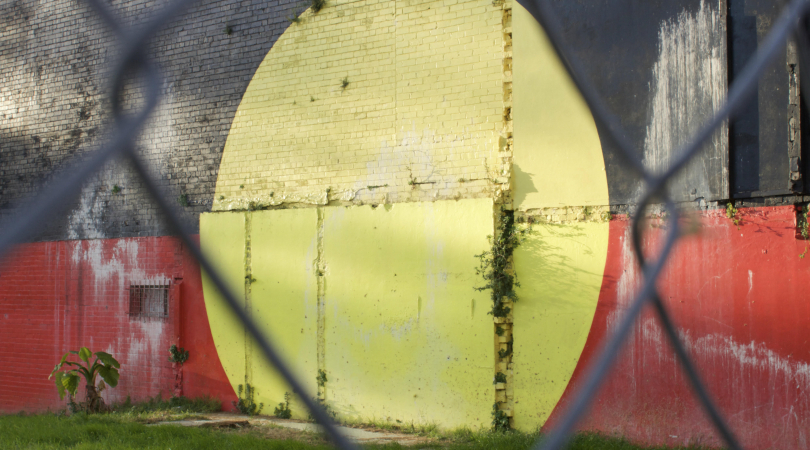 The Aboriginal flag painted on the side of a building in Redfern, Sydney is a famous landmark in an