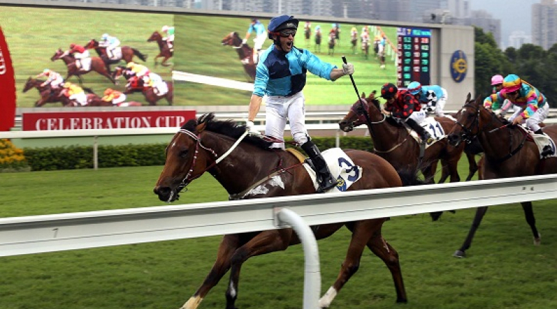 Jockey Neil Callan celebrates winning one of the biggest races of the Hong Kong racing calendar, the