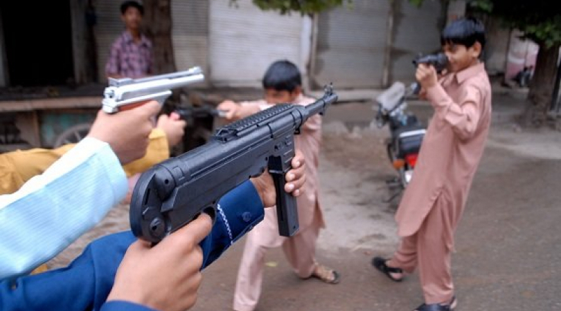 Pakistani children playing with gun toys. (Photo: Shahab ur Rahman)