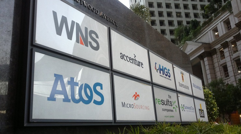The names of mostly multinational IT-BPO companies are seen at the entrance of a building at Eastwoo